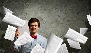 Image of young tired man holding folder with documents